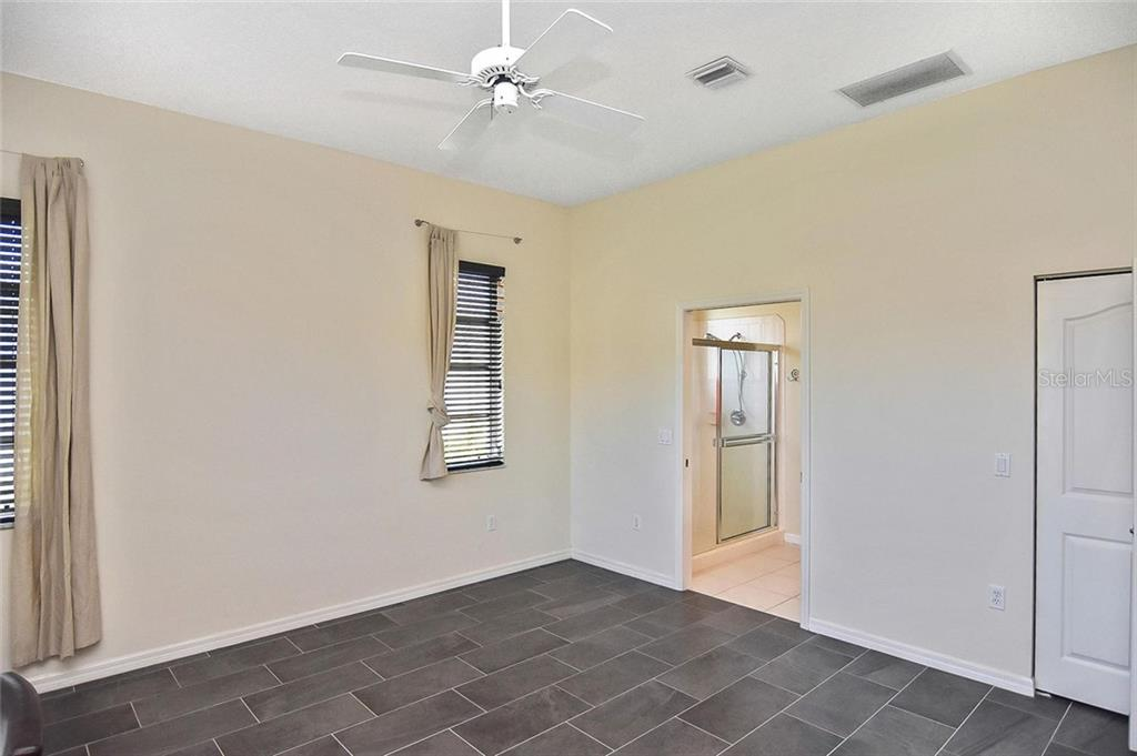 Master bedroom to master bath - Single Family Home for sale at 724 Silk Oak Dr, Venice, FL 34293 - MLS Number is N6102801