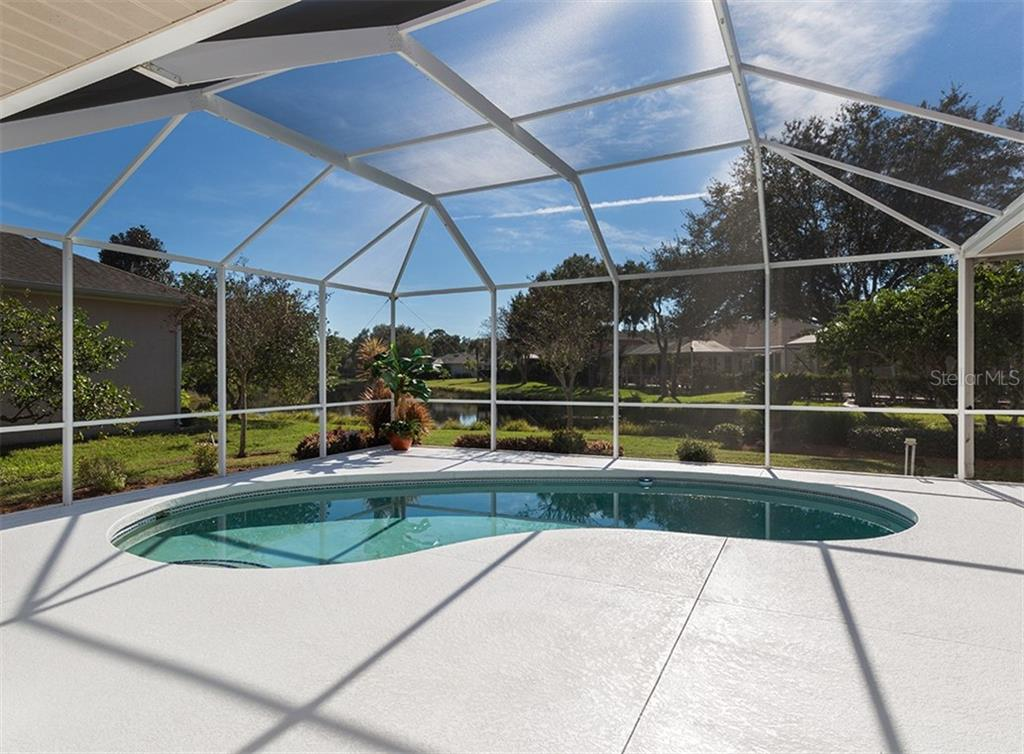 Pool with lake view - Single Family Home for sale at 2201 Sonoma Dr E, Nokomis, FL 34275 - MLS Number is N6103410