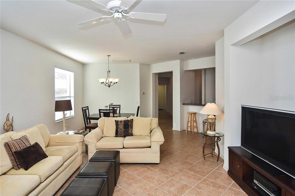 Living room, dining room - Villa for sale at 11108 Batello Dr, Venice, FL 34292 - MLS Number is N6104651