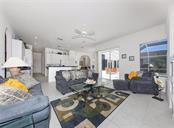 Family room to kitchen - Single Family Home for sale at 2201 Sonoma Dr E, Nokomis, FL 34275 - MLS Number is N6103410